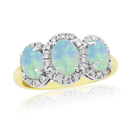 Gold oval cut three opal and diamond trilogy cluster ring